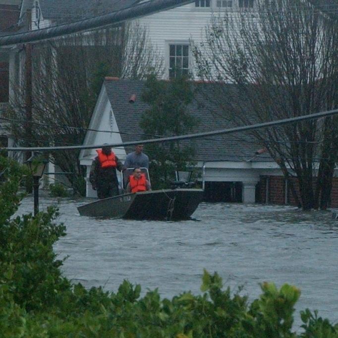 Hurricane Katrina. Boat passing Post HQ and Building 35