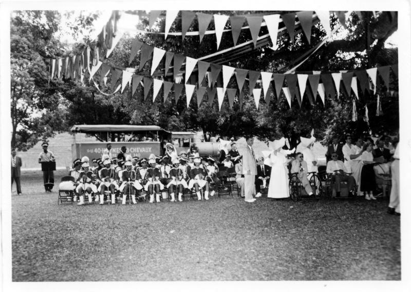 High School Band entertaining patients under the live oaks, National Leprosarium, Carville, LA