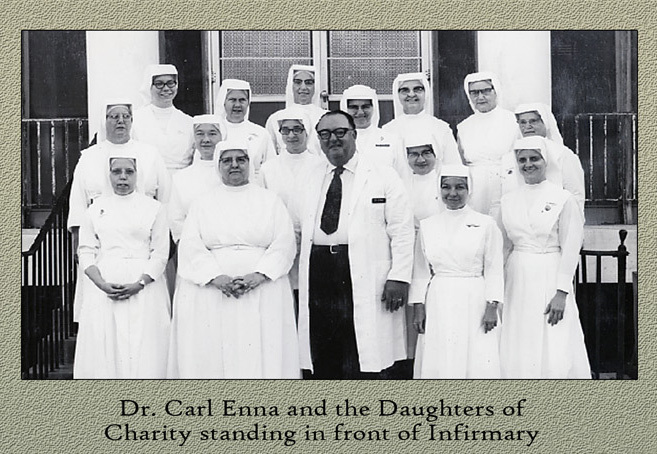 Dr. Carl Enna and Carville nursing staff in front of Infirmary, 1973.&lt;br /&gt;<br />