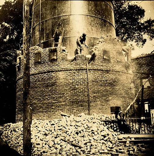 One of the south towers being demolished, circa 1912