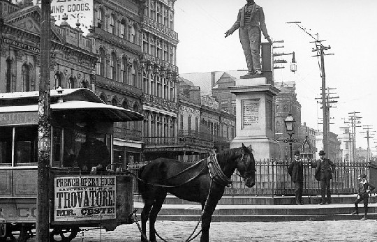 Mule-drawn streetcar of the period on Canal Street at the Henry Clay Statue.