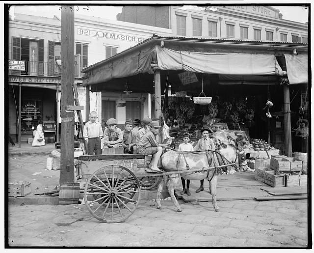 Children aboard produce wagon, French Market