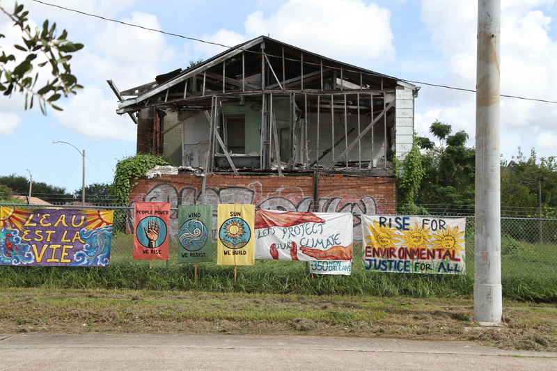 Fenced adorned with Protestors Signs infront of Abandoned apartment building in Gordon Plaza,